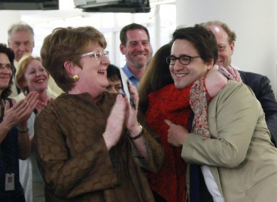 Executive AP editor Kathleen Carroll, left, applauds as reporter Adam Goldman, centre, is hugged after winning the Pulitzer Prize for Investigative Reporting.