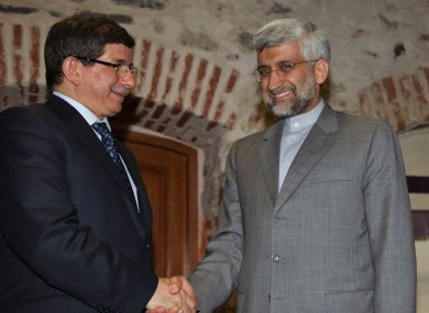 Turkey's Foreign Minister Ahmet Davutoglu, left, and Iran's Chief Nuclear Negotiator Saeed Jalili