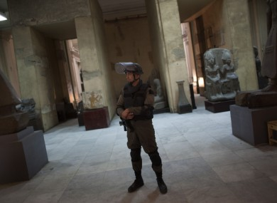 Egyptian special forces member guarding the Egyptian Museum in Cairo after looters broke in in early 2011.
