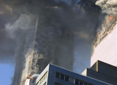 The World Trade Center towers on fire after the planes hit