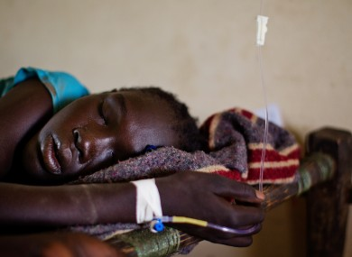 A teenage girl sleeps in a hig fever,suffering from Malaria in South Sudan, Africa