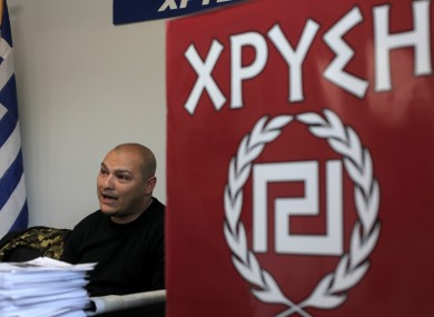 Golden Dawn candidate Giorgos Germanis at a party office in Artemis, Greece