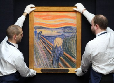 Sotheby's staff hanging The Scream at the auction house.