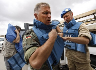 UN observers prepare for their visit to Hama city today.