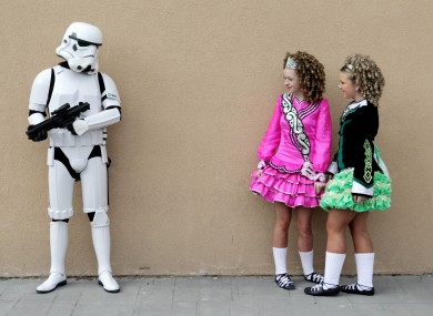 Irish dancers Sarah Duggan, 13, (left) and Shannon Tone, 14, comes across a Storm Trooper at the Citywest Convention in Dublin today