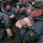 Police detain a protester in downtown St Petersburg, Russia at the same time Vladimir Putin's inauguration as president in Moscow. (AP Photo/Dmitry Lovetsky)