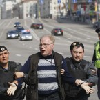 Police detain protesters in downtown Moscow ahead of Vladimir Putin's inauguration today. (AP Photo/Ivan Secretarev)