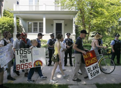 Police and protesters outside Mayor Rahm Emanuel's house today.