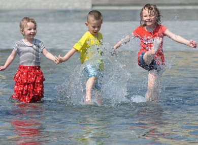 Two-year-old Lucy Beck (left), Callum Beck, aged three and Ruby Beck, aged four, enjoy the water at City Park, Bradford today.