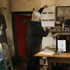 Barry Edgar Pilcher puts up a poster in his living room which was a polling station for the Fiscal Compact referendum on Inishfree Island, off Donegal. (Niall Carson/PA Wire)