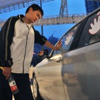 Qiu Jianjun indulges in a special type of athletic endeavour - he competed for five years for the right to use a BMW 1 Series car in Chengdu, Sichuan, China. He had to keep a hands on the stickers and had only a 15-minute break every four hours. (CDSB/ChinaFotoPress/PA Wire)