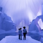 Children stand in a multimedia installation about global warming's effect on glaciers at the Green Nation Fest environmental show in Rio de Janeiro, Brazil. (AP Photo/Victor R. Caivano)