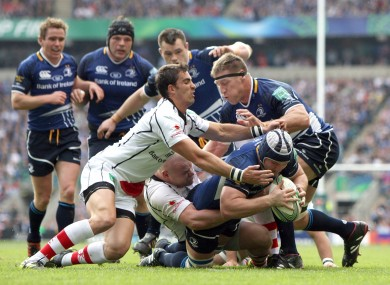 Leinster's Sean O'Brien hands off Craig Gilroy of Ulster.