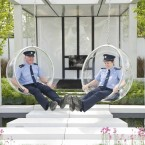 Gardaí Barry Heffernan and Pauline Firth take a seat in the garden 'Amach Agus Isteach' designed by Alan Rudden and David Ryan. (Photo: Laura Hutton/Photocall Ireland)