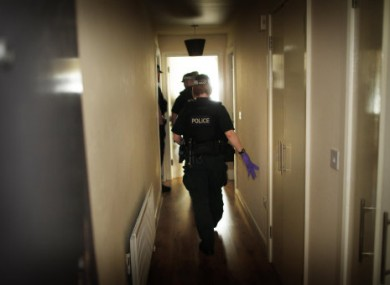 PSNI Organised Crime Branch officers enter and search an apartment in Belfast city centre, Northern Ireland during Operation Quest.