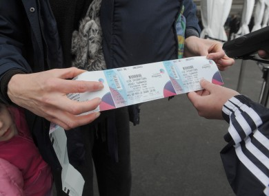 Spectators have their tickets inspected pass through the security gates as they enter the Olympic Park prior to the London 2012 Test event preview at the Olympic Stadium, London