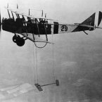 1921: A biplane suspends a model wing during a test flight in June 1921. (NASA Archives)