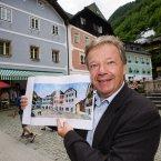 The mayor of the Austrian Hallstadt, Alexander Scheutz, standing in the town square. Image: AP Photo/Kerstin Joensson.