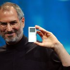 Steve Jobs, shown here displaying the iPod mini in 2004, was given a posthumous Grammy for creating