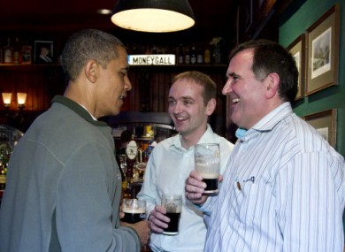 Henry Healy, centre, with Obama and Moneygall pub owner Ollie Hayes.