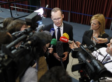 Media - domestic and international - listen to Fine Gael director of elections Simon Coveney at Dublin Castle yesterday.
