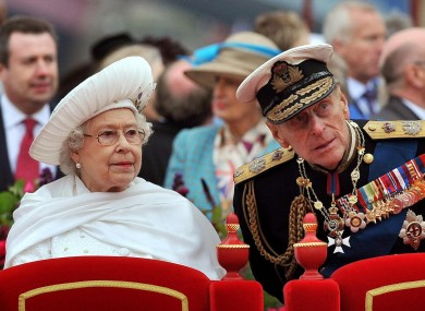 Queen Elizabeth II and the Duke of Edinburgh during the Diamond Jubilee River Pageant on the River Thames in London yesterday.