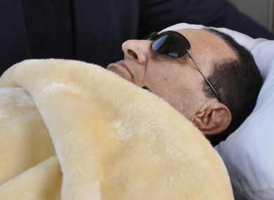 Former Egyptian president Hosni Mubarak is wheeled into court in Cairo, Egypt, for a hearing in January. State-run media are reporting Mubarak as being 'clinically dead'.