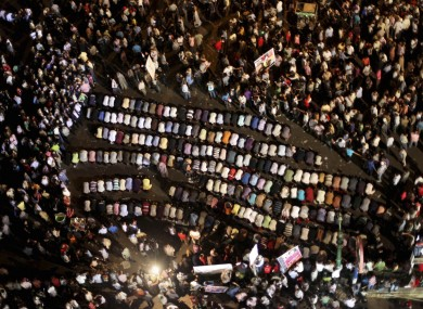 Egyptians pray at a protest in Tahrir Square in Cairo earlier.
