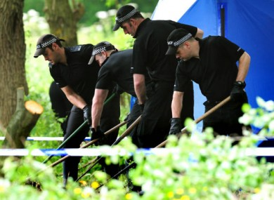 Police searching an area of parkland in Coventry.