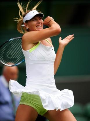 Maria Sharapova in action against Australia's Anastasia Rodionova.