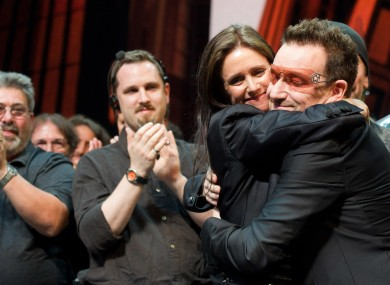 Julie Taymor and Bono appear onstage at the curtain call for the opening night performance of the Broadway musical
