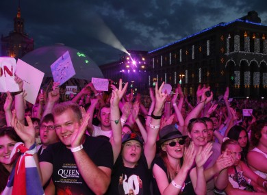 People react during a performance from musician Elton John at a Fan Zone during the Euro 2012 soccer championship in Kiev.