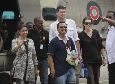 Released aid workers Horat Sadosay, Glenn Costes, centre, Steven Dennis, centre-back, and Astrid Sehl, center-right.