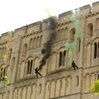 As the Olympic Flame run continues, it took an abseil down the side of Norwich Castle trailing coloured smoke this week. (Yui Mok/LOCOG/PA Images)