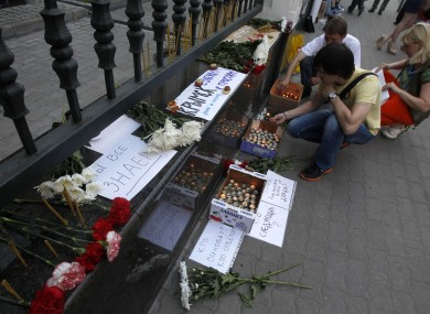 People light candles in memory of victims of the flood in Krasnodar region outside the office of the Representation of Krasnodar region in Moscow yesterday.