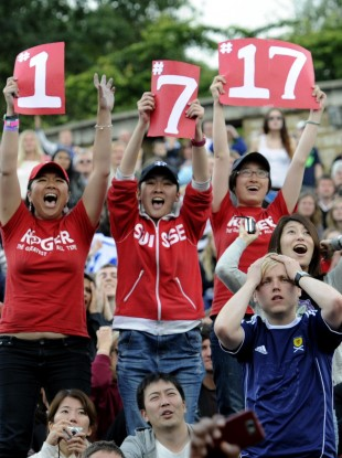 An Andy Murray fan (in the Scotland shirt) isn't thrilled to be reminded of Roger Federer's ranking, Wimbledon record, and overall Grand Slam record.
