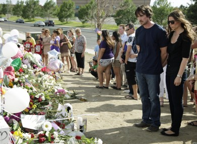 Christian Bale and his wife Sibi Blazic visit the memorial in Aurora, Colorado.
