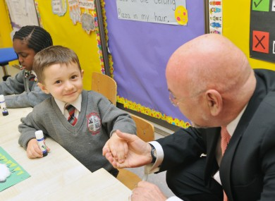 You did good, kid. Ruairí Quinn meets junior infant Joshua Ghuzian at a school in Ongar last year.