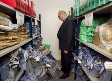 Environment minister Phil Hogan examines bags of household charge payment forms ahead of the March 31 deadline.