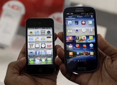 The Apple iPhone 4s, left, and the Samsung Galaxy S III.