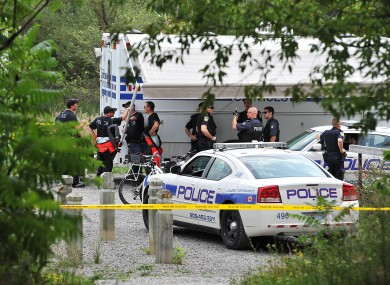 A police team is seen in Hewick Meadows Park in Mississauga, Ont., after discovering a female severed head in the Credit River