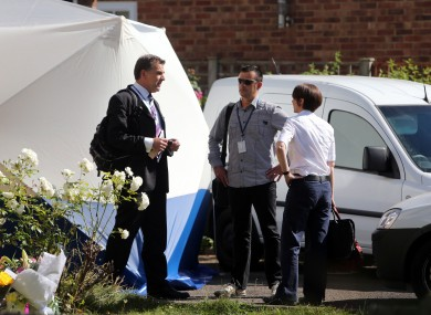 British and French police officers (identities not known) talk outside the home of French shooting victim, Saad al-Hilli in Claygate, Surrey.