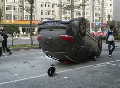 A mobile phone photo shows a car overturned in Foxconn's industrial zone in Taiyuan, following a mass brawl involving thousands of staff.