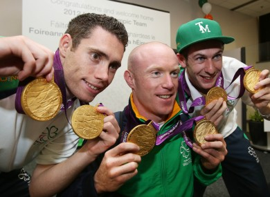Jason Smyth, Mark Rohan and Michael McKillop each show off their two Paralympic gold medals.