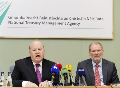 Minister for Finance Michael Noonan (left) and Chief Executive of the NTMA, John Corrigan, will be pleased at the outcome of this morning's auction.