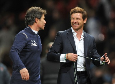 Villas Boas celebrates after the final whistle with first team fitness coach Jose Mario Rocha.