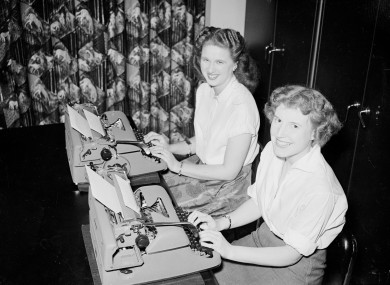 Typists Margaret Mitchell (l) and Barbara Stack (r) at their typewriters as they prepare to represent Great Britain at the World Typing Championships to be held in Monaco in 1955. We think their office equipment has already gone the way of the dodo.