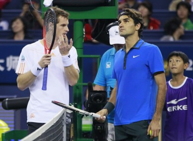 Andy Murray and Roger Federer discuss rain drops.