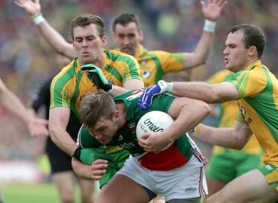 Neil and Eamon McGee combine to tackle Mayo's Aidan O'Shea.