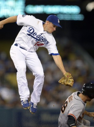 San Francisco Giants' Brandon Belt, right, steals second as Los Angeles Dodgers second baseman Mark Ellis in LA last night.